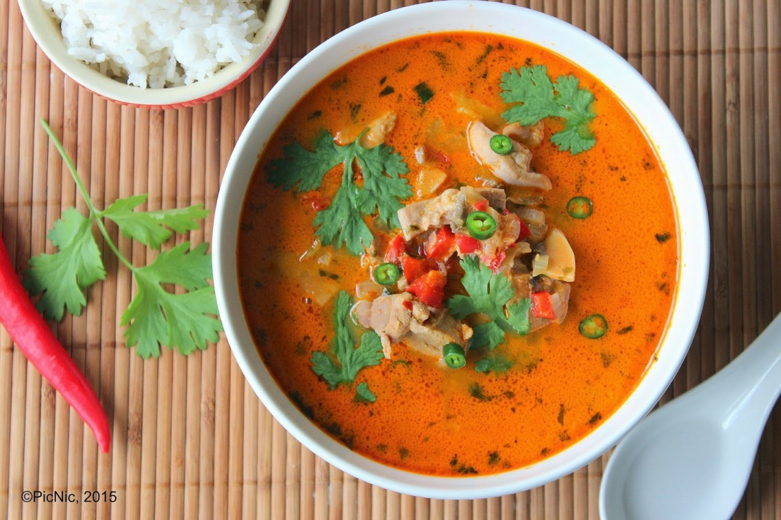 Thai red curry above close with text